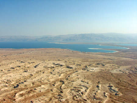 The desert below Masada, Israel with the Dead Sea in the background.