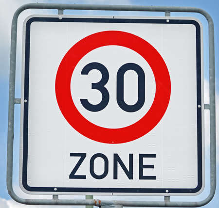 high section: 30 Kilometer Zone Road Sign