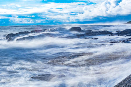 Waves flowing on the La Boquita Beach of Nicaragua. Stock Photo