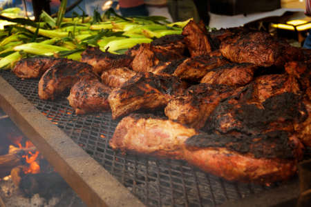 Large Party size Barbegue Beef and corn blazing over a wood burning BBQ.
