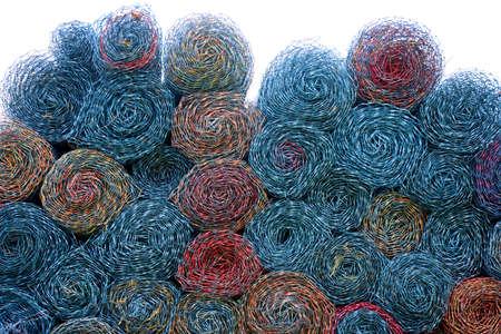 Colorful rolled chain link, swirled and stacked in circle pattern, fades to white at the top. Standard-Bild