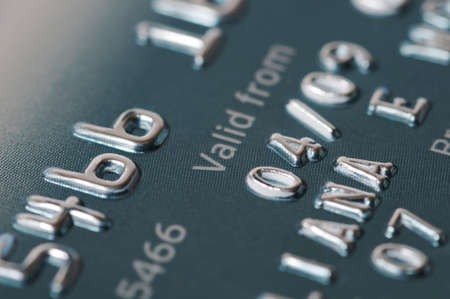 Credit card numbers shot close up showing the words Valid From and the date.