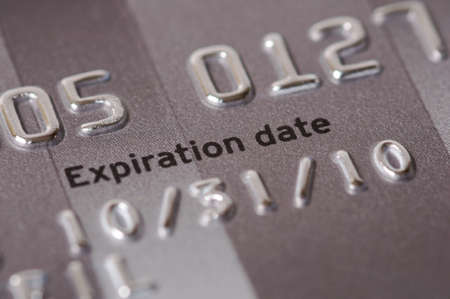 up date: Credit card numbers shot close up showing the words Expiration Date and showing the date.