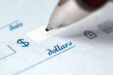 Extremem close up of the dollar amount on a check being written by an ink pen. photo