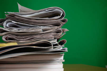 Stack of reading and research magazines and newspaper, a fading way we find information today