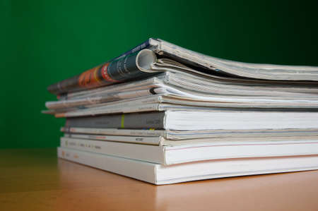 Stack of reading and research magazines, a fading way we find information today