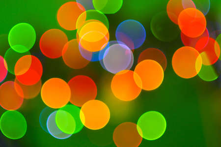 String of holiday colored lights in an abstract background pattern.