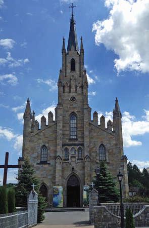 neogothic: Stone neo-Gothic Church of  St Jacek Hyacinth in Chochoow, Nowy Scz, Poland