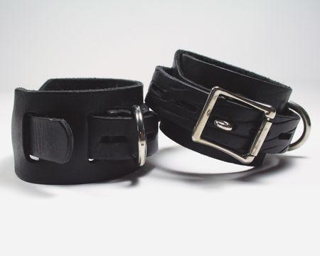 kink: Bondage cuffs on white background Stock Photo