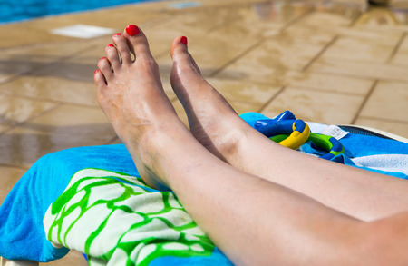 painted toes: Womans legs on a sunbed Stock Photo