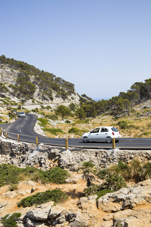 twist cap: A car travelling along narrow mountain roads in Mallorca
