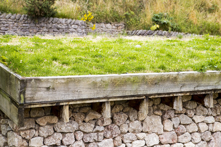 A green roof, or a living roof on top of a stone building