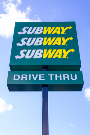 thru: Subway fast food sign.  The Sign outside the Subway sandwich drive thru on Kirkstall Road in Leeds