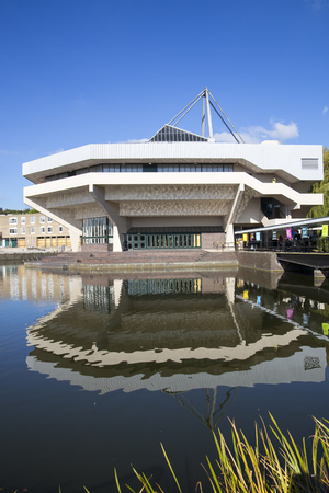 University of York. Central hall building on the main campus of York University viewed across the lake with reflection