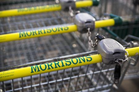 morrison: LEEDS, UK 9 FEBRUARY 2016.  Morrisons supermarket trolley showing logo outside supermarket in Leeds, UK.