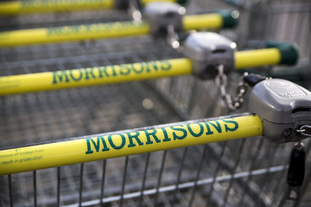 retailing: LEEDS, UK 9 FEBRUARY 2016.  Morrisons supermarket trolley showing logo outside supermarket in Leeds, UK.