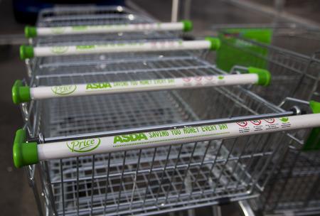 trolly: LEEDS, UK 9 FEBRUARY 2016. Asda Supermarket trolley outside superstore in Leeds.