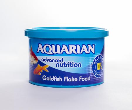 LEEDS, UK - 4 JANUARY 2017.  Aquarian fish food - fish flakes for goldfish