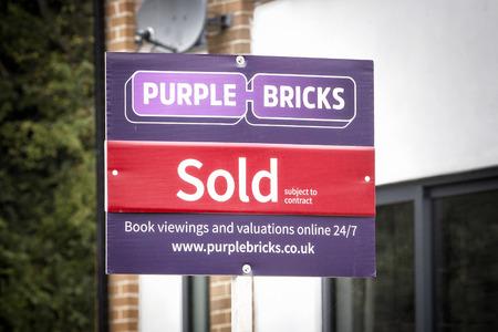 real estate sold: Purple Bricks British Online Estate Agent sign Editorial