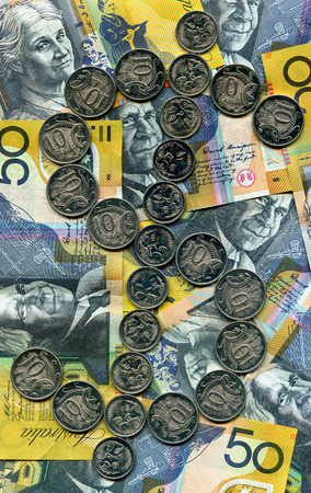 coinage: A dollar sign utilizing australian silver coinage with 50 dollar notes