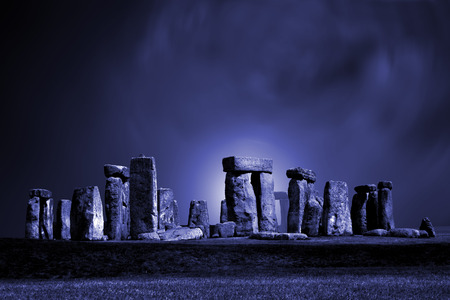Strange lights at the ancient stone circle Stonehenge in England photo