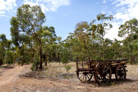 scrub grass: An abandoned wagon in the desert landscape of the Australian bush