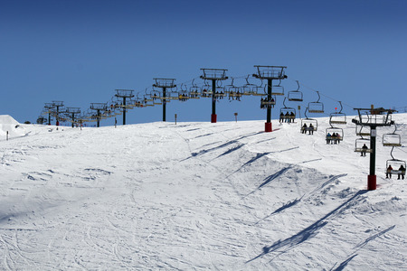 chairlift: Skiers on a chairlift at a popular ski resort in Australia