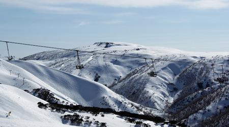 sun lit: Sun lit ski lift on a snow covered mountainside in Australia
