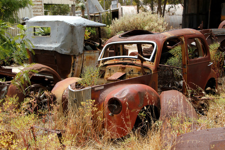 discarded metal: The final resting place for two old cars