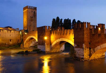 vechio: An evening view of the Ponte Scaligero Castel Vechio Bridge across the river Adige in Verona Italy Editorial
