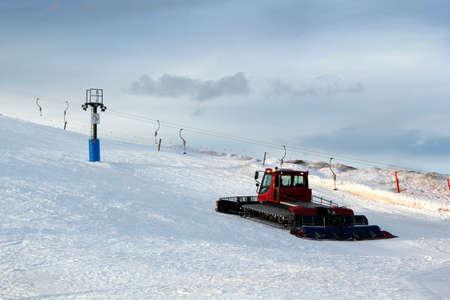 grader: A snow grader in action on the ski slopes