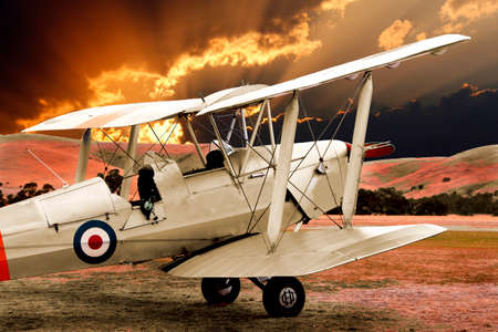 standby: A trainer biplane on standby waiting for the dawn