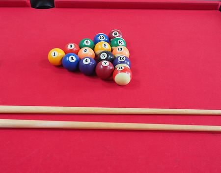 pool hall: Game of American billiards played on a billiard table for two persons