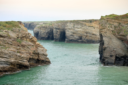 Beach of the cathedrals so called by the stone arches reminiscent of a church Stock Photo