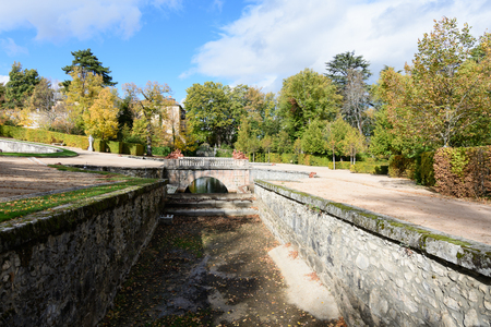 Gardens in autumn with the hoist in tones gilded in the province of Segovia, Spain Stock Photo