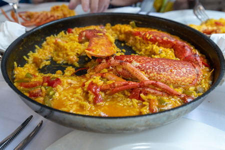 rice with lobster typical dish of sea bass in spain 写真素材