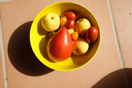 Healthy food based on tomato, cherry anda apple,color red and yellow