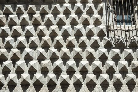 facade of a house formed by triangular pieces like peaks