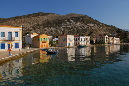 unfold: Traditional houses unfold to in front of the port in Kastellorizo,Greece