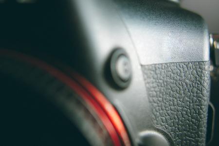 Close up of a black DSLR cameras body Stock Photo