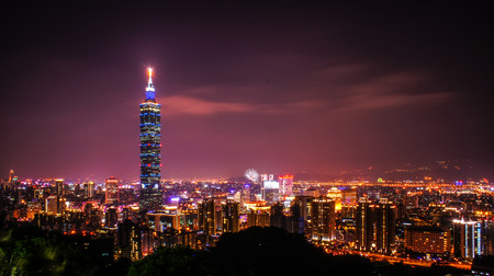 Taipei, Taiwan - Feb 17, 2010: Tower in Xinyi Commercial District, A romantic evening in Taipei, capital city of Taiwan, with dramatic rosy afterglow in the sky