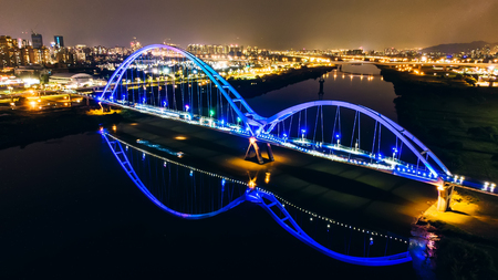Crescent Bridge - landmark of New Taipei, Taiwan with beautiful illumination at night, photography in New Taipei, Taiwan.