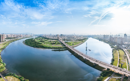 Taipei City Aerial View - May 6, 2018: Asia business concept image, panoramic modern cityscape building bird's eye view under sunrise and morning blue bright sky, shot in Taipei, Taiwan. 新聞圖片