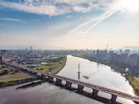 Taipei City Aerial View - May 6, 2018: Asia business concept image, panoramic modern cityscape building birds eye view under sunrise and morning blue bright sky, shot in Taipei, Taiwan. 新聞圖片