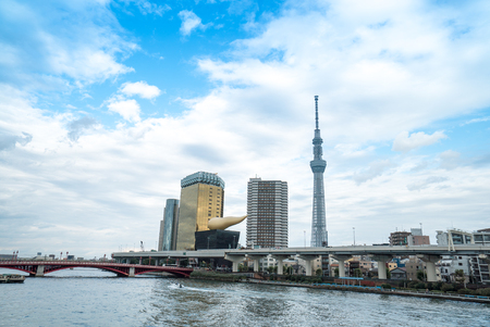 October 29, 2016: Tokyo skyscraper across the river in Asakusa including the Tokyo Skytree and the Asahi Beer Hall in Tokyo, Japan