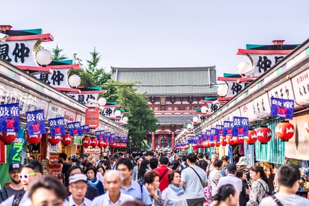 TOKYO, JAPAN - June 22, 2018 : Sensoji temple at Asakusa neighborhood, tourists are very happy to pay homage to blessing. This area has many shops & shopping center. One of Tokyo's must-see places to visit