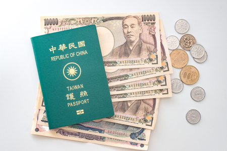 Japanese yen banknotes, Japanese yen coin and ROC Taiwan passports 写真素材
