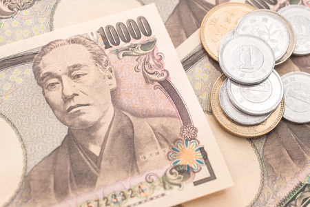 Japanese yen banknotes and Japanese yen coin Stock Photo