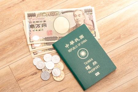 Japanese yen banknotes, Japanese yen coin and ROC Taiwan passports Stock Photo