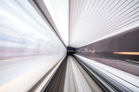 Motion blur of train moving inside tunnel with  light in tokyo, Japan.